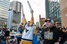 Bill Garrard, center, of Friendship watches the Penguins score in Game 5 Thursday at the team's watch party outside PPG Paints Arena.
