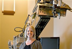 "Rebecca Hartley, director of operations for the Clemson University Center for Workforce Development and chief workforce officer for the Advanced Robotics in Manufacturing Institute, stands in front of the ""Workhorse,"" one of the first robots built by the institute designed to clean-up contaminated sites."