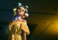 A model pauses on the runway, her dress and headpiece inspired by the sun, at the Ecolution fashion show on April 20, 2017, at the Fairmont Pittsburgh, Downtown. The event returns April 19 for its fourth year.