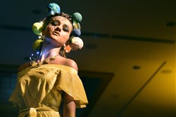 A model pauses on the runway, her dress and headpiece inspired by the sun, at the Ecolution Fashion Show on April 20, 2017 at the Fairmont Pittsburgh hotel, Downtown.