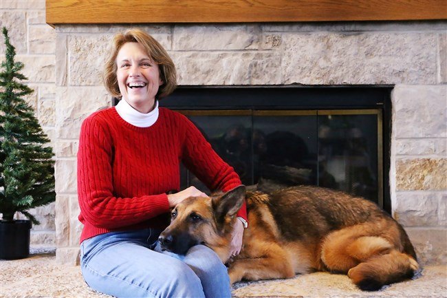 Deana Noonan, with her dog Journey, runs Noah's Rest, a group that takes pets for domestic abuse victims while they escape dangerous situations in the Chicago area.