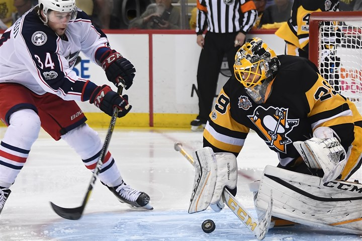20170420pdPenguinsSports04 Marc-Andre Fleury makes a save on a shot from the Blue Jackets' Josh Anderson in the second period Thursday at PPG Paints Arena.