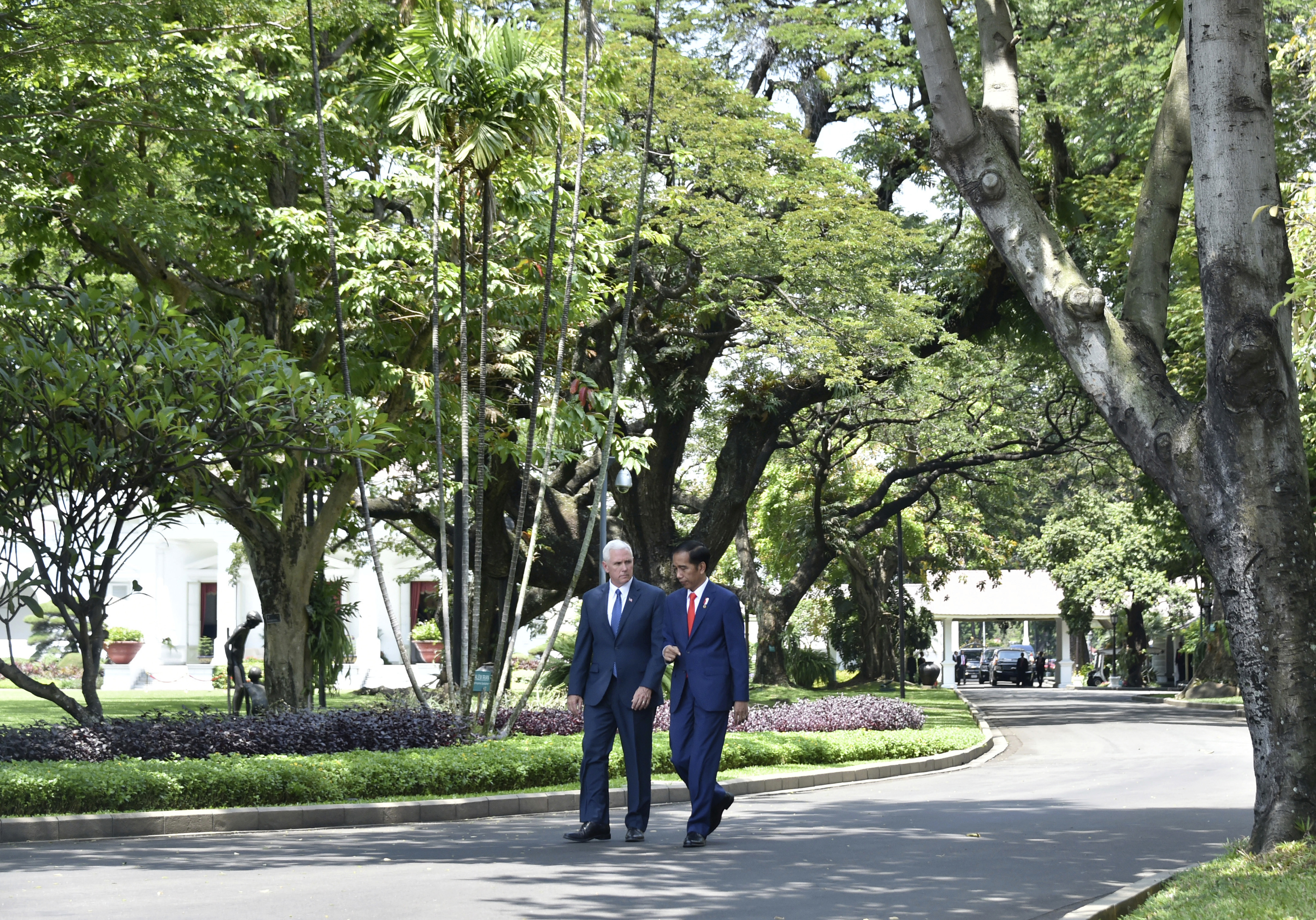 Indonesia Pence-1 U.S. Vice President Mike Pence, left, walks in the garden of Merdeka Palace with Indonesian President Joko Widodo during their meeting in Jakarta, Indonesia, Thursday, April 20, 2017. Indonesia is the latest stop on an Asian tour by Pence that is reinforcing traditional U.S. alliances at a time when Donald Trump's presidency has raised questions about the strength of the U.S. commitment to the region. (Bay Ismoyo/Pool Photo via AP)