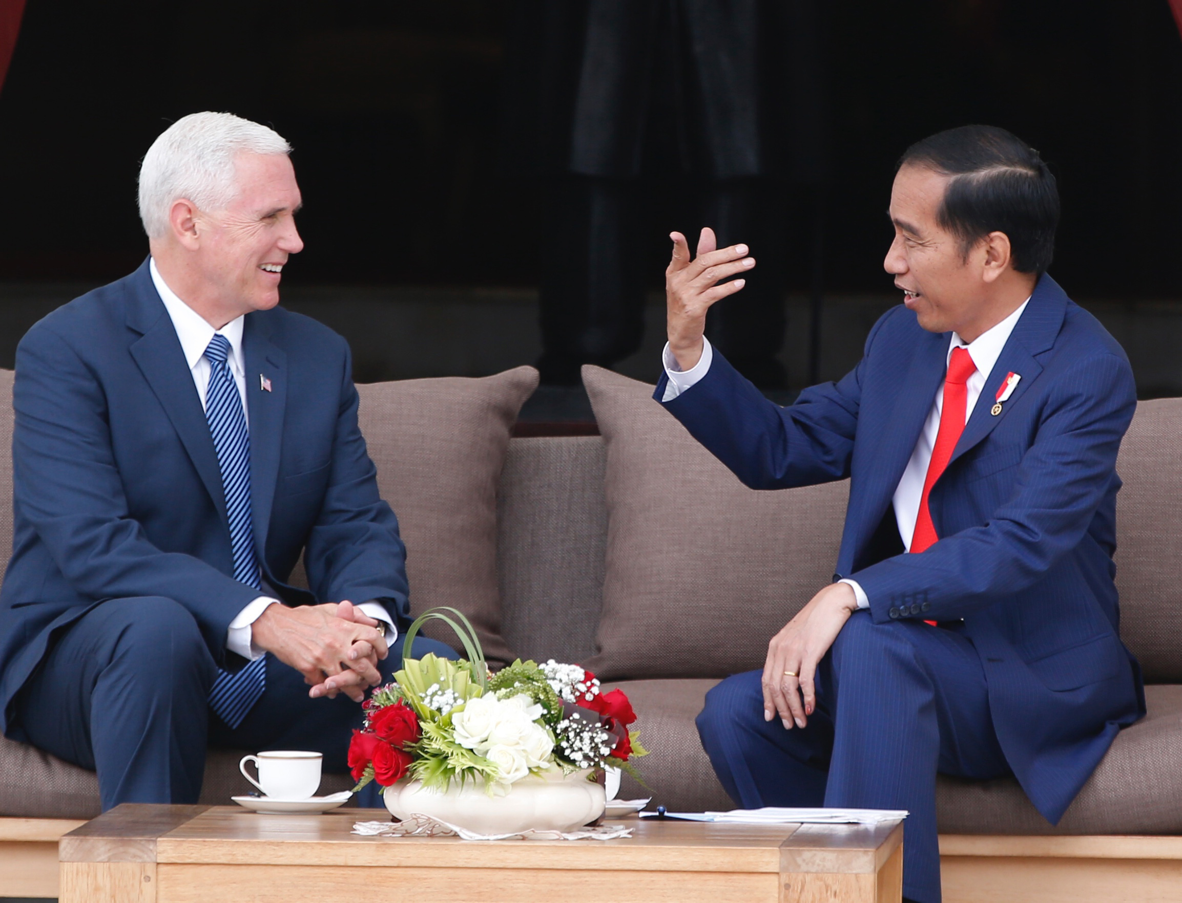 Indonesia US Pence-3 U.S. Vice President Mike Pence, left, meets with Indonesian President Joko Widodo at the presidential palace in Jakarta, Indonesia Thursday, April 20, 2017.(Darren Whiteside/Pool Photo via AP)