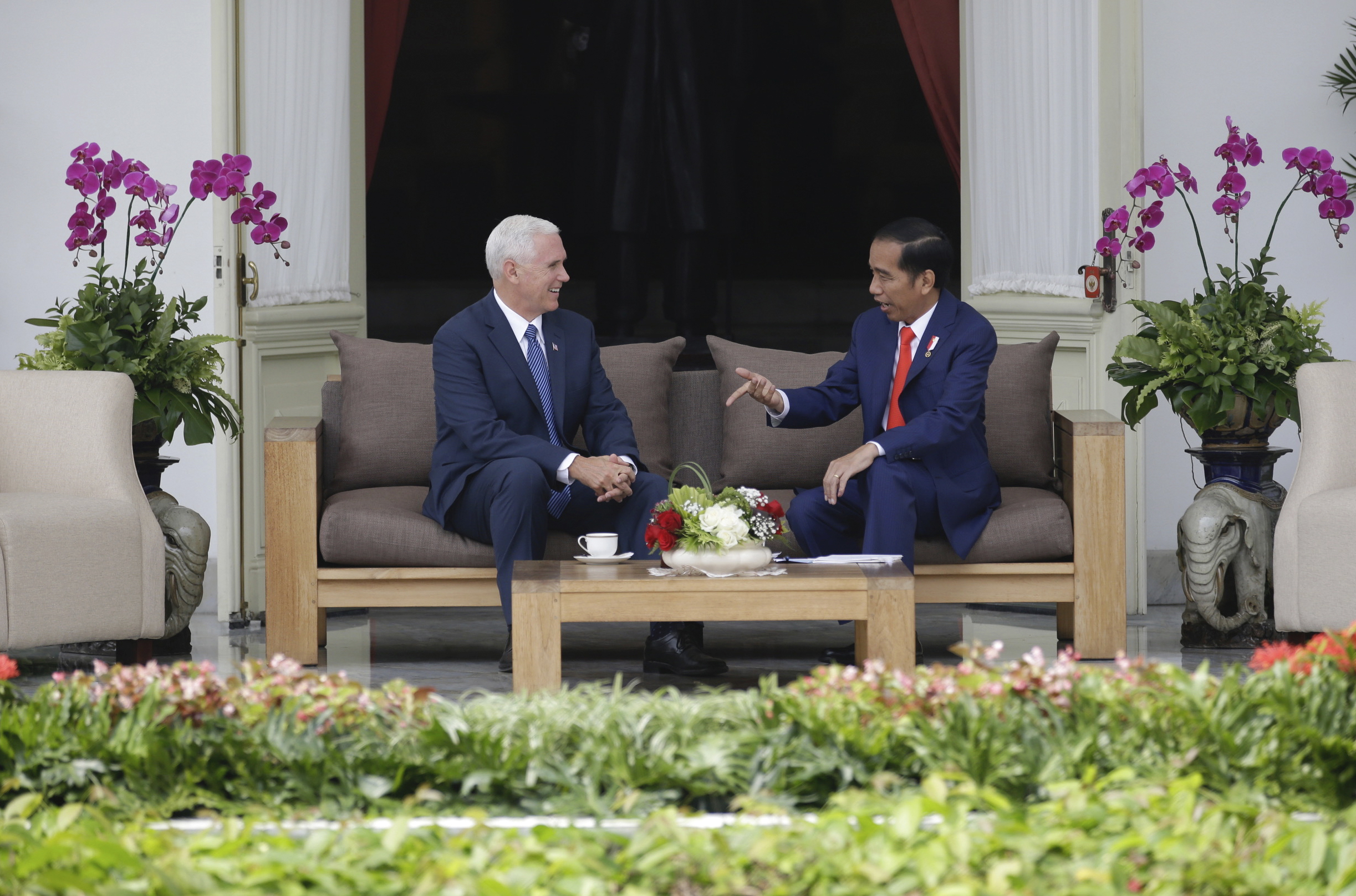 Indonesia US Pence U.S. Vice President Mike Pence, left, confers with Indonesian President Joko Widodo during their meeting at Merdeka Palace in Jakarta, Indonesia, Thursday, April 20, 2017. Pence is currently on a 10-day trip in Asia. (AP Photo/Dita Alangkara, Pool)