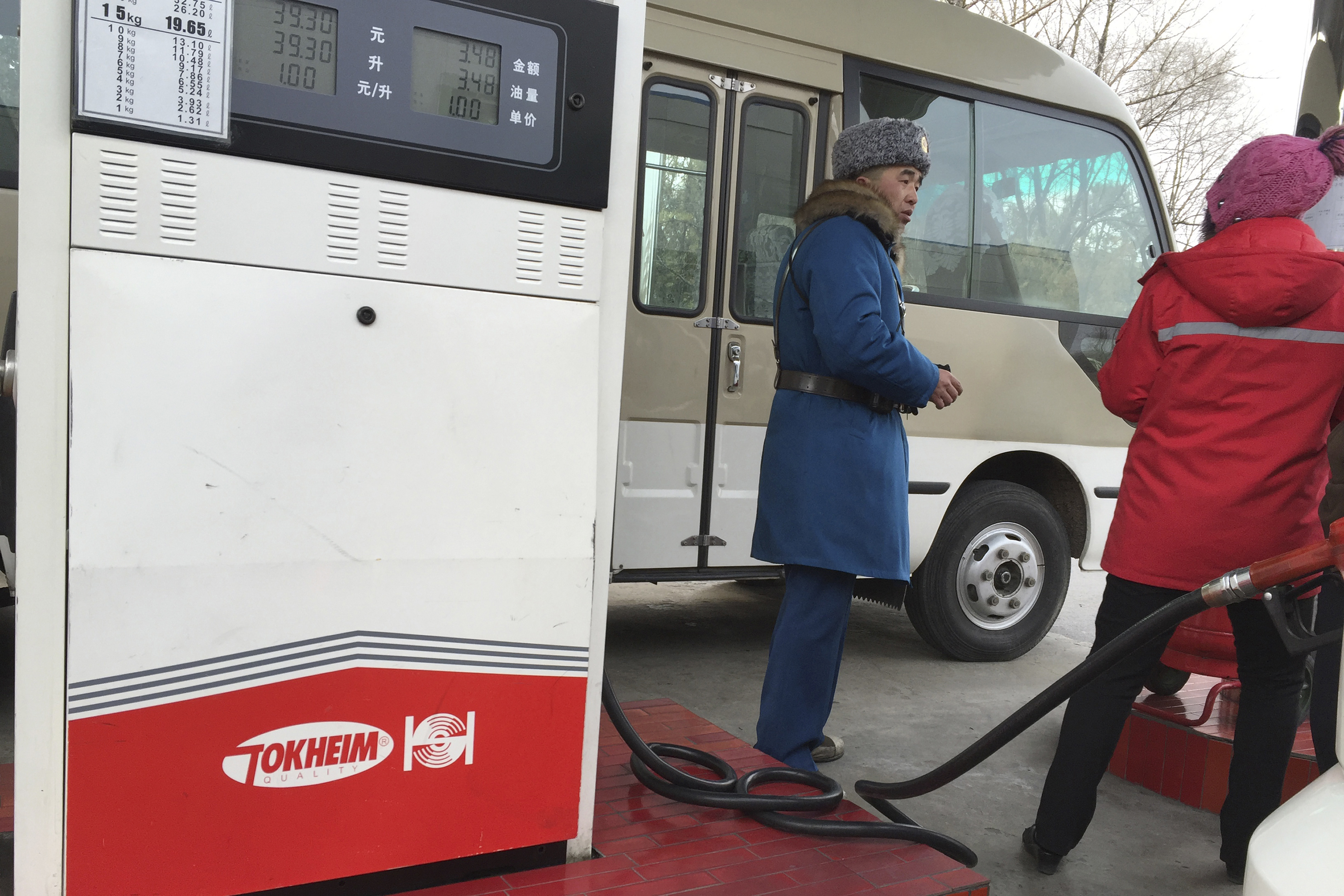 North Korea Gas FILE - In this Feb. 22, 2016, file photo, a customer talks to a gas station attendant in Pyongyang, North Korea. Car users in Pyongyang are scrambling to fill up their tanks as gas stations limit services and close their gates amid concerns of a possible shortage. The cause of the restrictions or how long they might last were not immediately known. (AP Photo/Eric Talmadge, File)