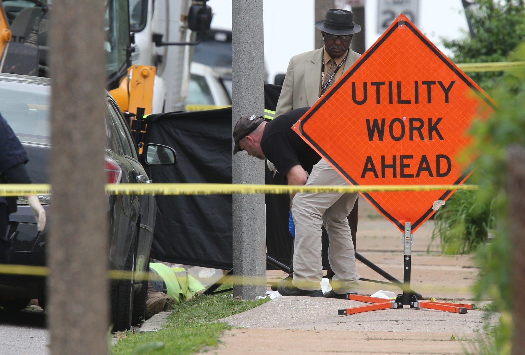 Utility Workers Killed-3 Police investigate a triple shooting in which two Laclede Gas workers were shot and killed in St. Louis on Thursday, April 20, 2017. Police say the shooter also shot and killed himself. (JB Forbes/St. Louis Post-Dispatch via AP)