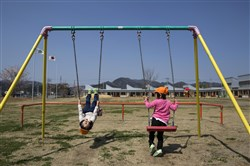 Children ride swings at the nursery school in Naraha, Japan, a hamlet in Fukushima, April 14, 2017. Six years after an earthquake and tsunami caused a meltdown at a nuclear power plant north of town, 105 students are returning to the schools here for the beginning of the Japanese school year.