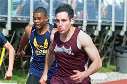 Ambridge's Isaac Elliott crosses the finish line first to win the 100-meter dash at the Butler Invitational April 21.