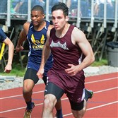 Isaac Eliott from Ambridge crosses the finish line to win the boys 100-meter dash Friday at the Butler Track and Field Invitational.