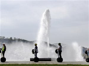 A group of people ride segways around the fountain on Friday, April 21, 2017 at Point State Park.