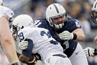 Penn State defensive tackle Parker Cothren pulls down running back Josh McPhearson during the Blue-White Game in April.