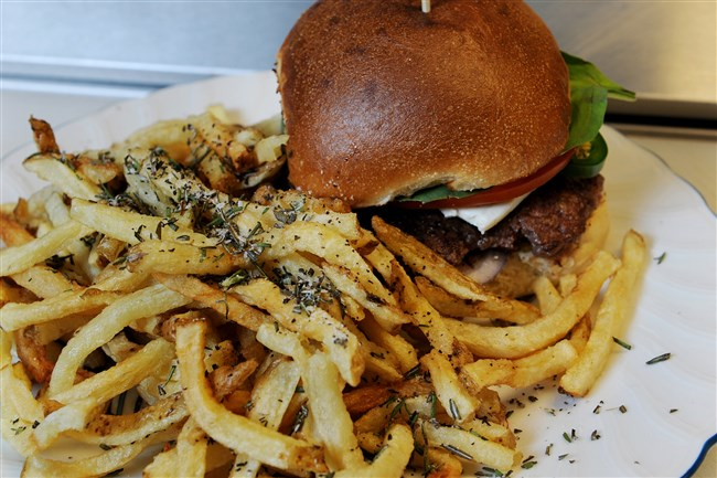 A  hamburger and fries prepared by Chef Fiore Moletz inside Burgh'ers in Lawrenceville.