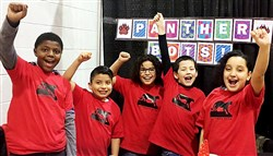 From left, Elijah Goodwin, 10, Angel Herrera-Sanchez, 9, Jose Verastagui, 10, Manuel Mendez, 9, and Devilyn Bolyard, 9, competed in the VEX IQ worldwide robotics competition last week in Louisville, Ky.