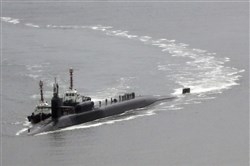 The nuclear-powered submarine USS Michigan approaches early Tuesday to join the U.S. aircraft carrier USS Carl Vinson in drills near the Korean Peninsula at Busan port in Busan, South Korea.