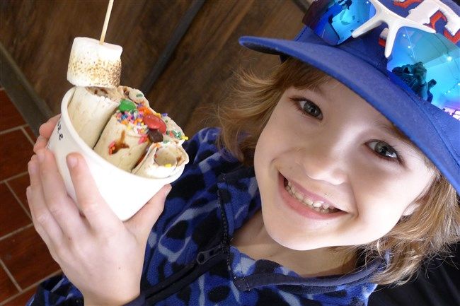 Six-year-old Colby Lane holds his S'more Loving rolled ice cream from 15 Fahrenheit in Mt. Lebanon.