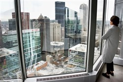 "Sofia Burno, the interior designer for    ""Industrious,"" looks at the Pittsburgh skyline from the 31st floor of One PPG Place. Industrious has office space , desks and conference rooms for ""start ups""."