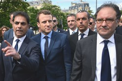French presidential election candidate for the En Marche! movement, Emmanuel Macron, second from left, along with Mourad Franck Papazian, co-president of France's Armenian Organizations Coordination Council; and CCAF co-president Ara Toranian, arrive for a ceremony Monday at a monument in memory of mass killings of Armenians by Ottoman forces in 1915 in Paris.