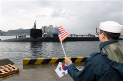 This image released by the U.S. Navy shows the Ohio-class guided-missile submarine USS Michigan being greeted on Tuesday as it arrives in Busan, South Korea, for a scheduled port visit while conducting routine patrols throughout the western Pacific.