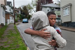 Agnes Thompson, left, of McKeesport hugs a boy who was a schoolmate of 14-year-old Will Chaffin.