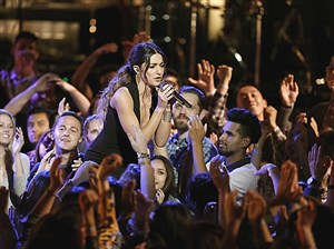"Carnegie Mellon grad Lilli Passero works the crowd during her performance April 24 on NBC's ""The Voice."""