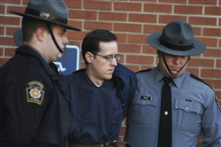 FILE - In this Jan. 5, 2015, file photo, Eric Frein is led away by Pennsylvania State Police Troopers at the Pike County Courthouse after his preliminary hearing in Milford, Pa. Prosecutors are seeking the death penalty against Frein, who they said targeted state police because he was trying to foment an uprising against the government. Frein's lawyers want the jury to sentence him to life without parole. (Butch Comegys/The Times & Tribune via AP, File)
