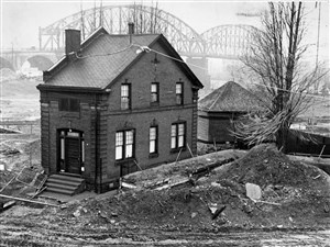 View of the custodian's house and entrance to the Fort Pitt Blockhouse at the Point in downtown Pittsburgh. Photographed on March 7, 1965, during construction of recreation of Fort Pitt.