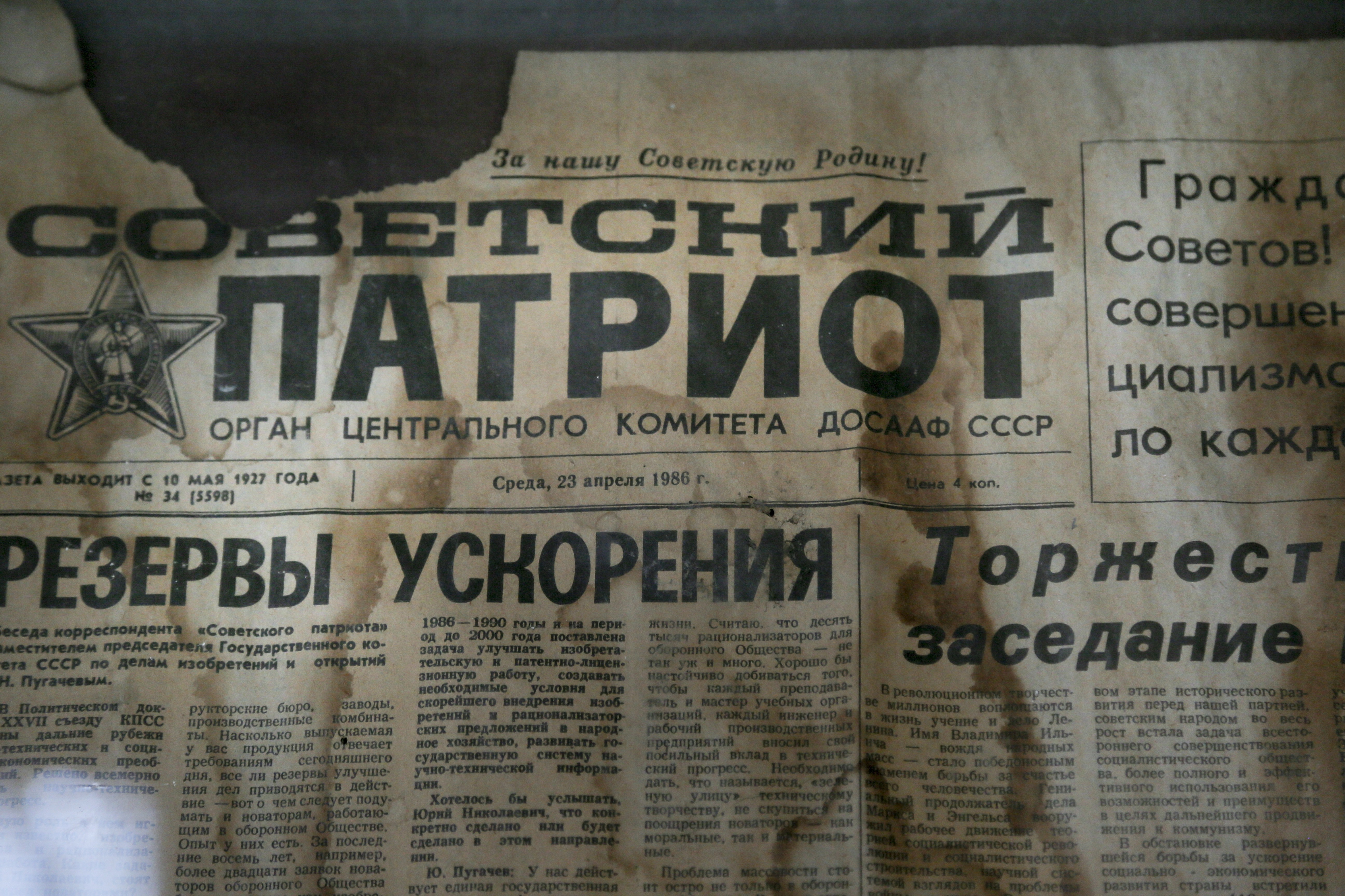 Chernobyl Aftermath-2 In this photo taken Wednesday, April 5, 2017, an edition of the newspaper Sovetsky Patriot, dated three days before the nuclear explosion, is attached to a bulletin board in a house of culture in the deserted town of Pripyat, some 3 kilometers (1.86 miles) from the Chernobyl nuclear power plant Ukraine. Once home to some 50,000 people whose lives were connected to the Chernobyl nuclear power plant, Pripyat was hastily evacuated one day after a reactor at the plant 3 kilometers (2 miles away) exploded on April 26, 1986. The explosion and the subsequent fire spewed a radioactive plume over much of northern Europe. (AP Photo/Efrem Lukatsky)