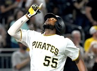 The Pirates' Josh Bell crosses home plate after hitting a home run against the Cubs in the sixth inning Wednesday.