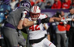 T.J. Watt had 11.5 sacks last season for Wisconsin.