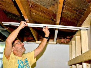 Ray Detig, a volunteer with St. Thomas Moore in Bethel Park, rebuilds a wall & shelf in a home on Rockridge Rd. in Connellsville as he helps out the Greater Connellsville Flood Recovery sponsored by Western Pennsylvania United Methodist Committee on Relief Wednesday.