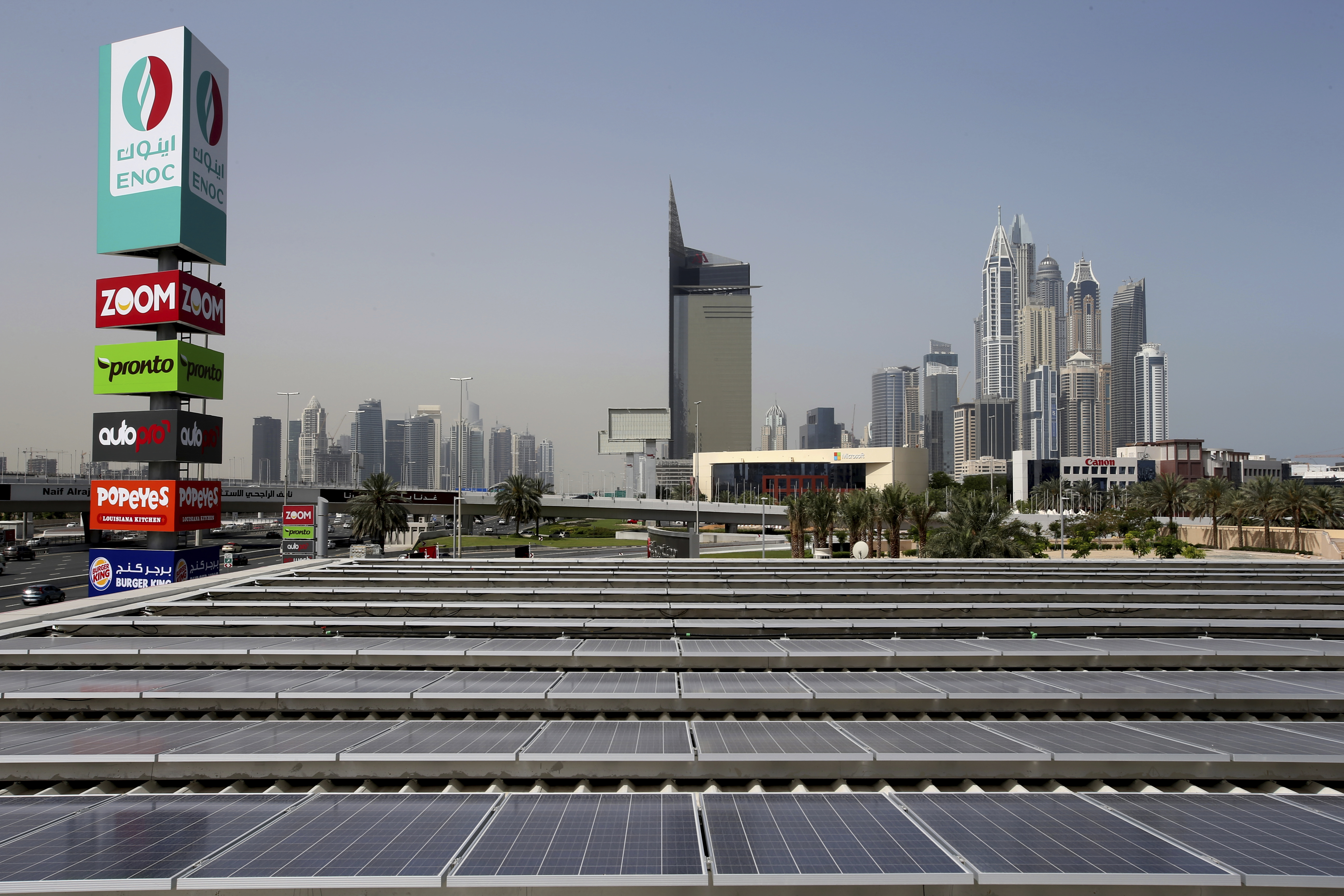 Dubai Solar Service Station-1 Solar panels power an Emirates National Oil Company gas station, in Dubai, United Arab Emirates, Thursday, April 27, 2017. The government-owned oil company said Wednesday the country's first solar-powered gas station in Dubai, on the city's main Sheikh Zayed Road thoroughfare, is covered with solar panels that can generate up to 120 kilowatt hours. (AP Photo/Kamran Jebreili)