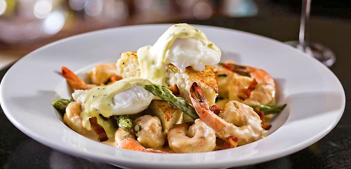 mothers day shrimp grits eddie v Shrimp and grits will be served with sauteed gulf shrimp over creamy cheese grits, finished with a shirred egg and crispy bacon at Eddie V's brunch on Mother's Day. The restaurant is Downtown.