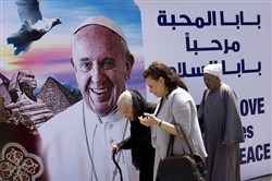 A billboard welcomes Pope Francis, at St. Mark's Cathedral in Cairo on Thursday.