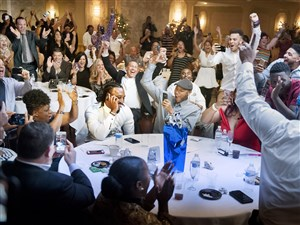 The room erupts around Malik Hooker, center, still on the phone with the Indianapolis Colts, as it is announced on TV that he will be joining their team at The Villa banquet hall on Thursday, April 27, 2017 in New Castle.