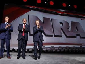 President Donald Trump stands with National Rifle Association Executive Vice President Wayne LaPierre, right, and Chris W. Cox, executive director of the National Rifle Association Institute for Legislative Action as he arrives for the National Rifle Association Leadership Forum, Friday, April 28, 2017, in Atlanta.