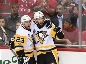 Nick Bonino celebrates his game winner with Scott Wilson late in the third period Thursday against the Capitals.