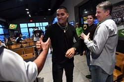 James Conner greets friends and family before his NFL draft watch party April 28 in Erie.