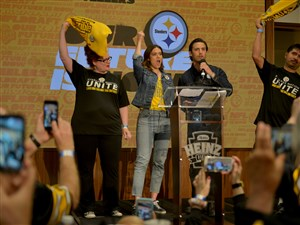 "While fans record the moment on their phones, Mandy Moore and Milo Ventimiglia, co-stars on the NBC Pittsburgh-based show ""This is Us,"" announce the Steeler's fourth-round draft pick during the annual Steelers Fan Blitz at Heinz Field Saturday, April 29, 2017. On the left is Steelers Nation Unite contest winner Heidi Thomas of Minneapolis and, to the right is Miguel Gaona."