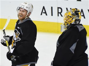 Patric Hornqvist and Marc-Andre Fleury share a laugh during Saturday's morning skate. (Peter Diana/Post-Gazette)