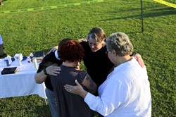 Gina Grimm, bottom left, daughter of inmate Jack Jones, prays with members of the Episcopal Church outside the Varner Unit on Monday near Varner, Ark. Jones and Marcel Williams received lethal injections on the same gurney Monday night, the first double execution in the United States since 2000.