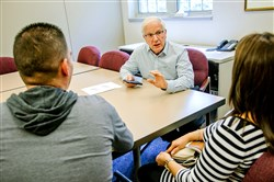 Jeffrey Herzog meets with a couple who immigrated from Cuba about their search for jobs at Jewish Family & Children's Service.  Mr. Herzog was nominated as a finalist for the Jefferson Awards for his volunteer work with the organization.