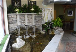The Outdoor Living Studio in Millvale offers waterfalls, ponds and other outdoor settings, built indoors, for customers to view.