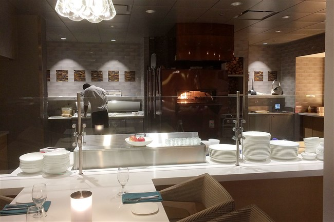The open kitchen and wood oven at Ember & Vine at the DoubleTree by Hilton Hotel Pittsburgh-Cranberry.
