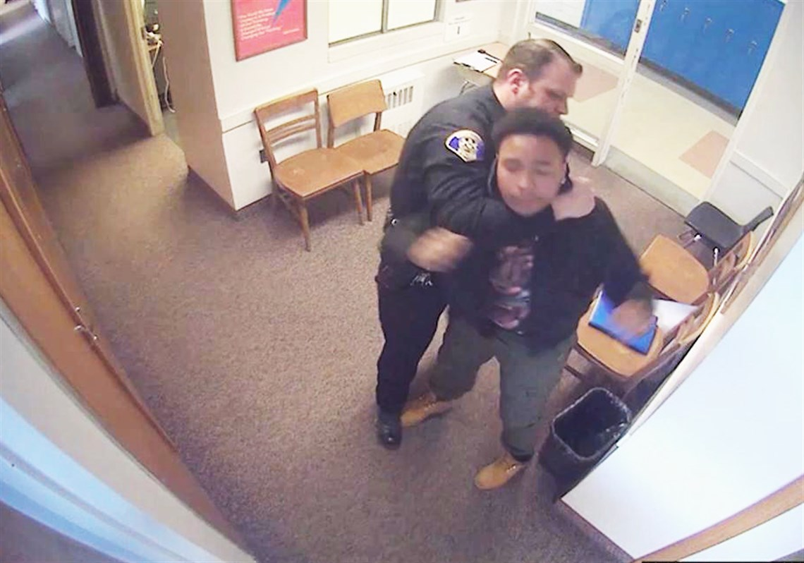 This screengrab from surveillance videos released Tuesday by attorney Todd  Hollis shows an incident involving a