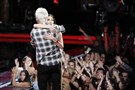 "CMU grad Lilli Passero gets a hug from her coach, Adam Levine, after learning she's moving on to the top 10 of NBC's ""The Voice."""
