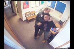 This screengrab from surveillance videos released last week by attorney Todd Hollis shows an incident involving a Woodland Hills student being subdued in a school office by police and school officials.
