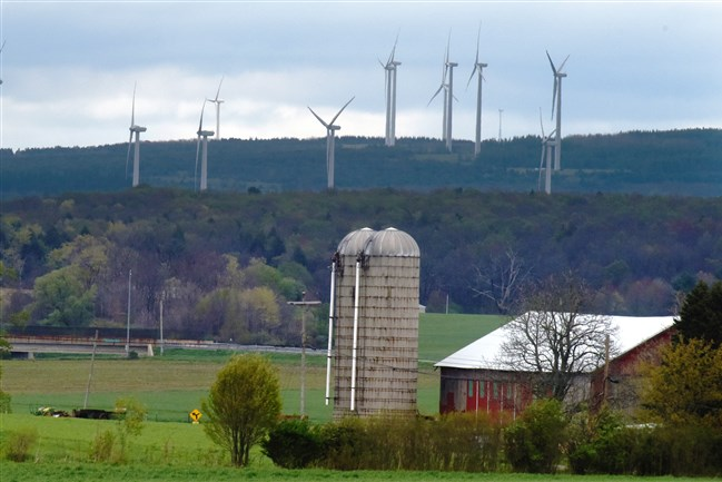 Wind turbines sprouted in the distant of this rural farm scene in Somerset County in May 2017.