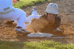 Central Catholic's Kyle Shaffer slides safely into first as Butler's Sam Gross catches the ball Wednesday at Butler Senior High School. Central Catholic defeated Butler, 2-1.