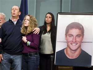 Jim and Evelyn Piazza stand by as Centre County District Attorney Stacy Parks Miller announces the results of an investigation into the death of their son Timothy Piazza.